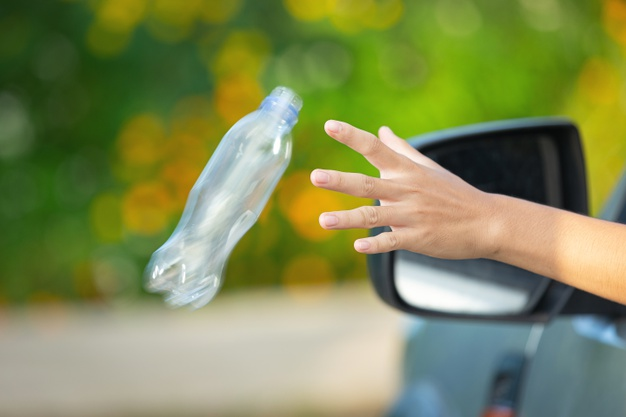 throwing-plastic-bottle-to the environment-waste